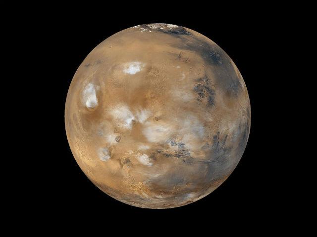 Шлейфы пыльных бурь на Марсе обычно не поднимаются выше 50 километров (фото NASA).
